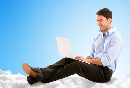 Business man working online from the cloud on his laptop