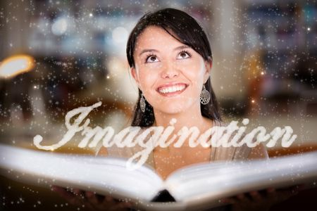 Woman reading a book and letting her imagination fly