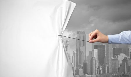 hand pulling green cityscape curtain to gray cityscape, environmental protection concept