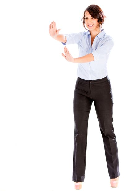 Business woman pushing an imaginary object - isolated over white