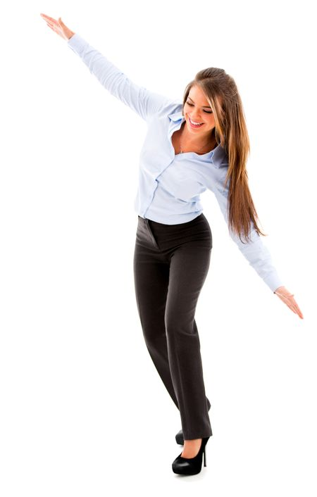 Business woman trying to fly - isolated over a white background
