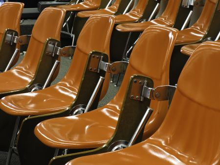 One size fits all: Identical shiny hard orange molded seats in lecture hall