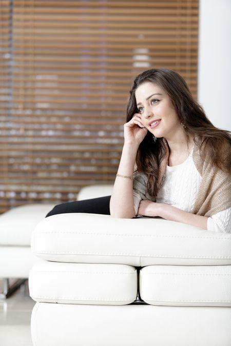Beautiful woman relaxing in her elegant living room.