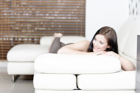 Attractive young woman relaxing on her sofa at home