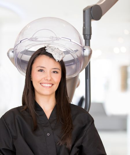 Woman at the hair salon changing her color