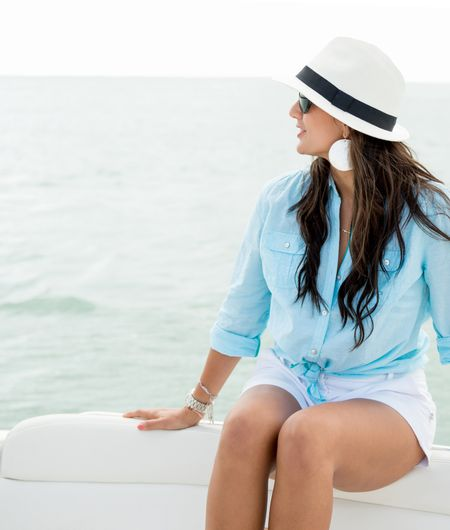 Beautiful summer woman sailing in a boat