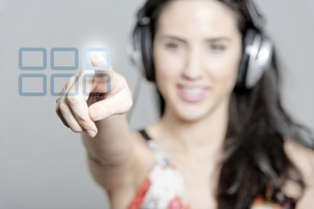 Woman selecting a song to listen to by pressing a concept button
