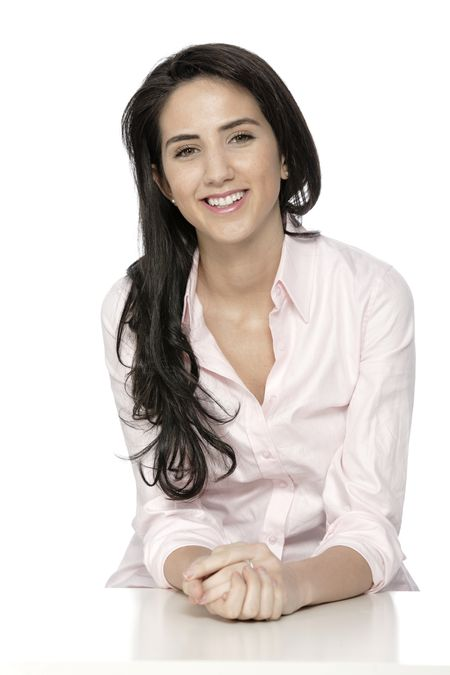 Attractive woman in shirt sat at white table smiling