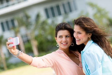 Women taking a picture of themselves with the mobile phone