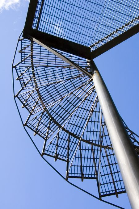 Spiral staircase to platform and blue sky
