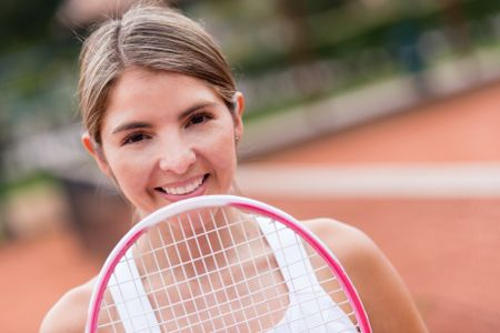 Portrait of a female tennis player with a racket