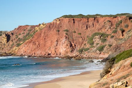Cliff Face and Bay at Amado Beach; Portugal; Europe