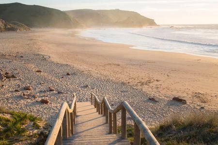 Wooden Steps down to Empty Amado Beach; Algarve; Portugal