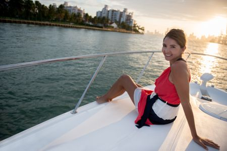 Beautiful woman enjoying the sunset on a yacht
