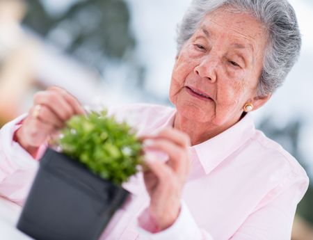 Retired woman gardening outdoors enjoying some fresh air