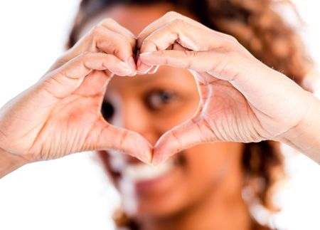Romantic woman making a heart - isolated over a white background