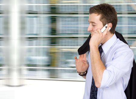 business on the move - cell phone conversation in a corporate environment