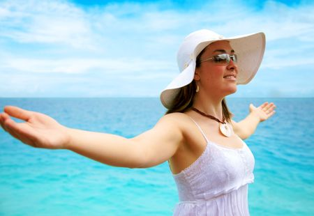 beach freedom woman with arms open enjoying peace and tranquiity