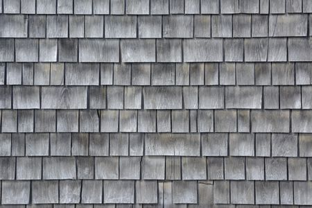 Siding of gray wood shingles with low environmental impact on house in Cape Cod, Massachusetts