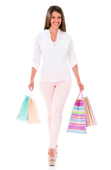 Happy shopping woman with bags - isolated over a white background
