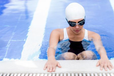 Woman in the swimming pool working out