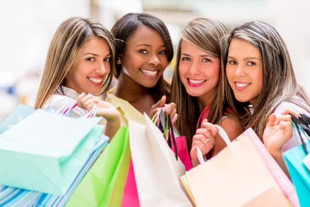 Group of shopping women holding bags ant looking happy