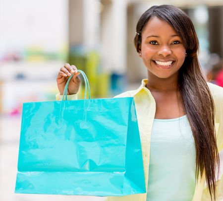 Happy woman portrait holding shopping bag and smiling