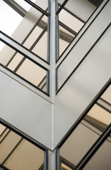 Corner of atrium with windows reflecting skylight
