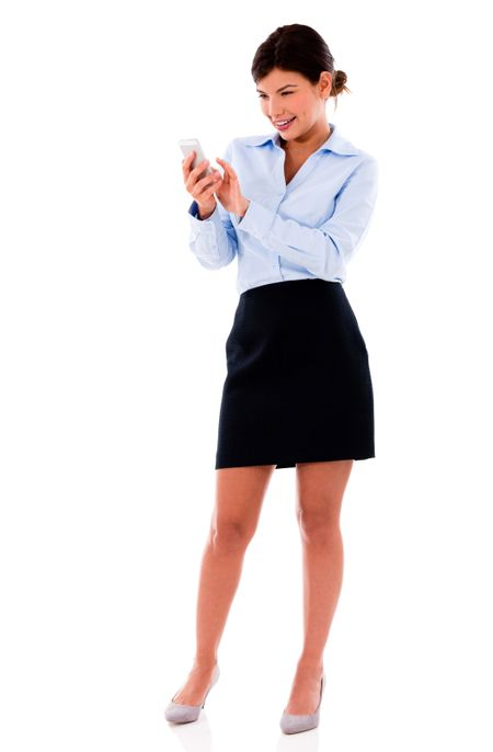 Business woman texting from a mobile phone - isolated over white background