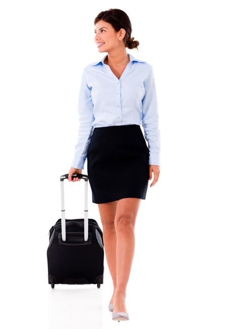 Successful woman on a business trip  isolated over white