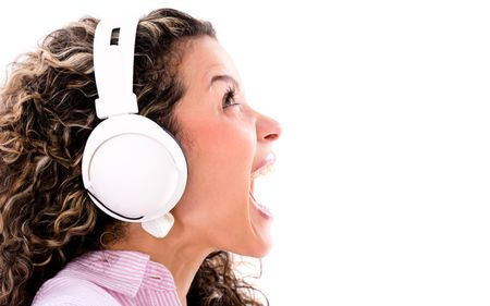Woman listening to music and singing loud - isolated over white background