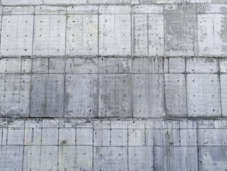 Institutional pattern with theme of beginnings: Section of exterior wall of poured concrete for large university building under construction
