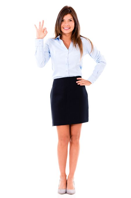 Happy business woman making an ok sing - isolated over a white background