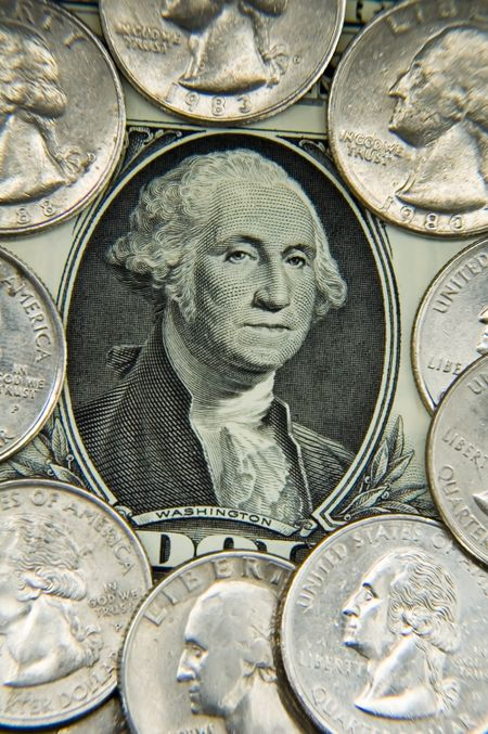 George Washington's face surrounded by quarters on U.S. dollar bill