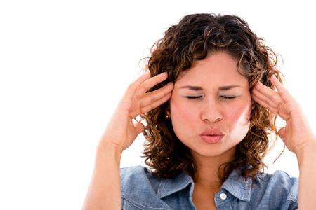 Frustrated woman with a headache - isolated over a white background