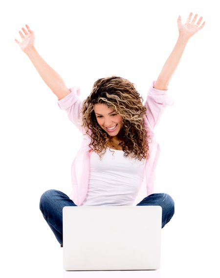 Successful woman with a laptop computer and arms up - isolated over white