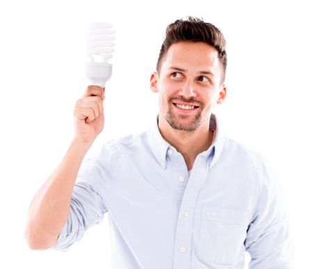 Man thinking of an idea holding an energy saving bulb - isolated over white