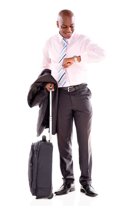 Man checking the time to go on a business trip - isolated over white