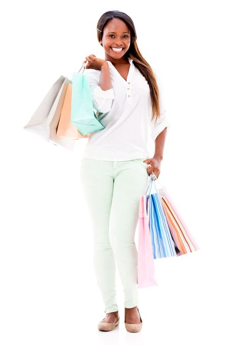 Happy female shopper holding shopping bags - isolated over white background