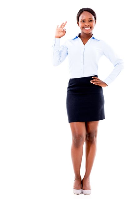 Business woman making an ok sing - isolated over a white background
