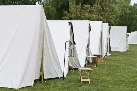 Row of white tents in Union camp at reenactment of American Civil War (1861-1865), Four Seasons Park, Lombard, Illinois, on July 27, 2013. Typically, the volunteer actors sleep in such tents at night.
