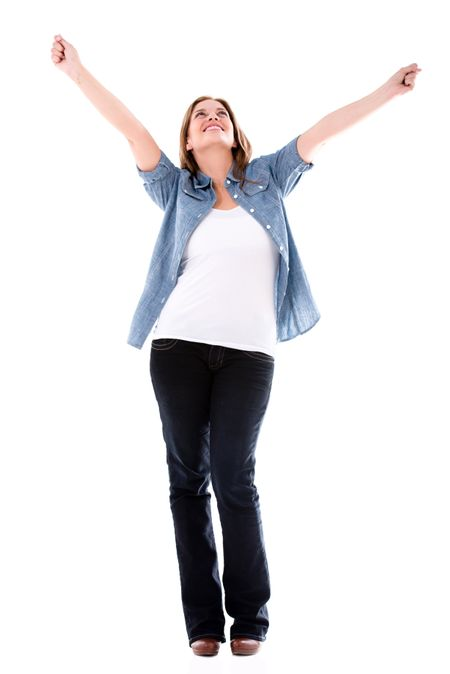 Happy woman with arms up enjoying her success - isolated over white
