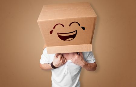 Funny man wearing cardboard box on his head with smiley face