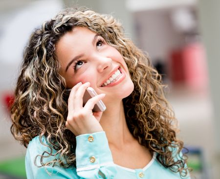 Woman talking on the phone and looking happy