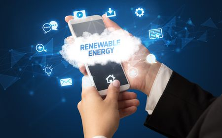 Female hand holding smartphone with RENEWABLE ENERGY inscription, cloud technology concept