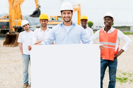 Architect holding a banner at a building site