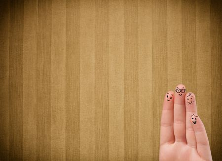 Happy finger smileys faces on hand with vintage stripe wallpaper background