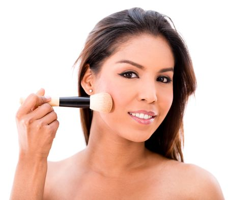 Beauty portrait of a woman applying makeup - isolated over white