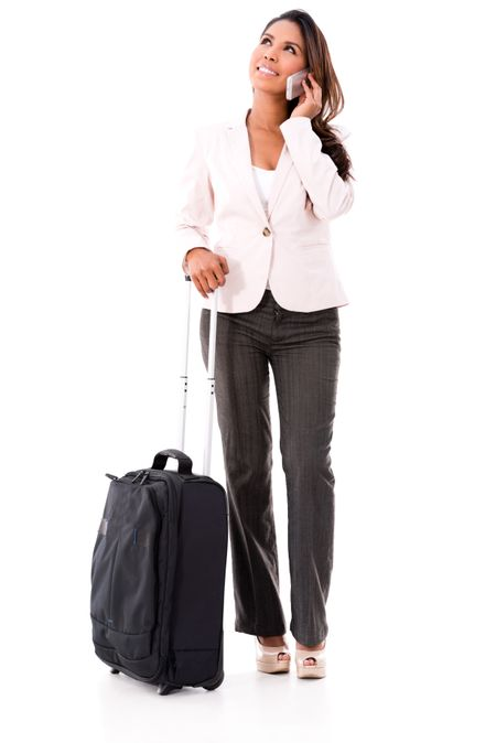 Woman going on a business trip and talking on the phone - isolated over white