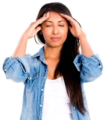 Stressed woman with a headache - isolated over a white background